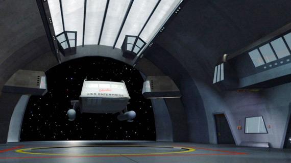 The Columbus enters the shuttle bay of the Enterprise on Star Trek.