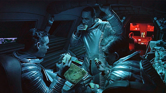 Heywood Floyd (William Sylvester, left) eats lunch on the Moonbus heading to a remote site in 2001.
