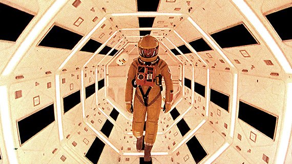 Dave Bowman walks a claustrophobic passageway within the spaceship Discovery in the film 2001.