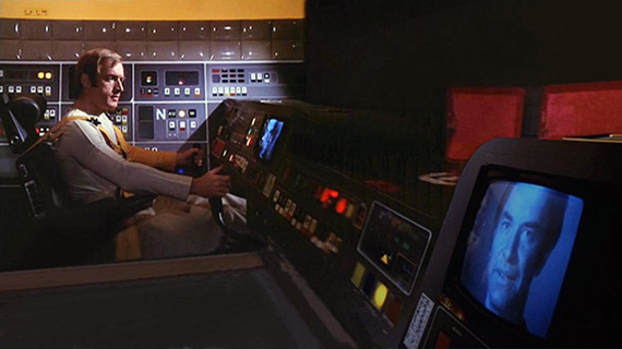 Alan Carter (Nick Tate) from Space: 1999 speaks with Commander Koenig in the Eagle cockpit.