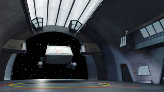 The Columbus enters the shuttle bay of the Enterprise on Star Trek.